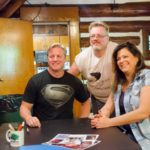 Scott Mann and Renee Blaine pose for photographs with fans